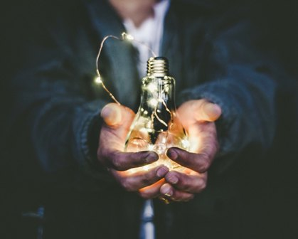 Thought Leadership - man holding lightbulb