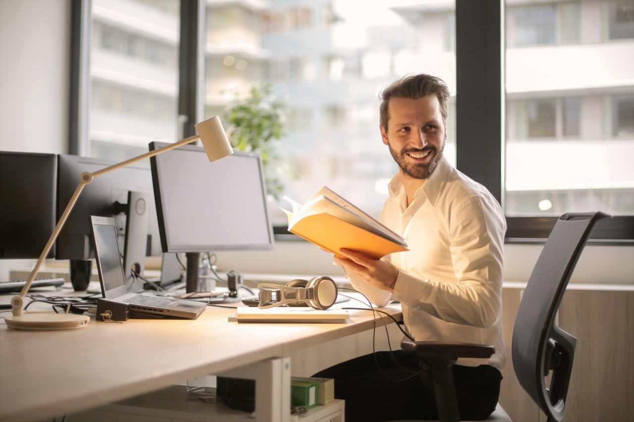 Adapting to Organizational Change - Man working at desk_smiling