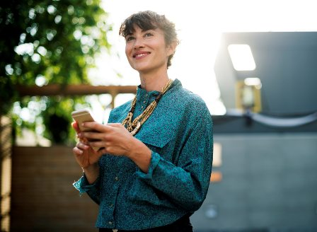 Asking for Raise-Promotion - Woman holding smartphone