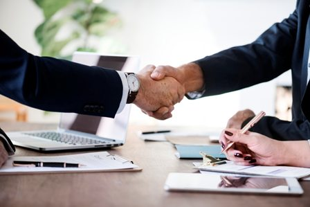 Employment Law - Handshake over desk