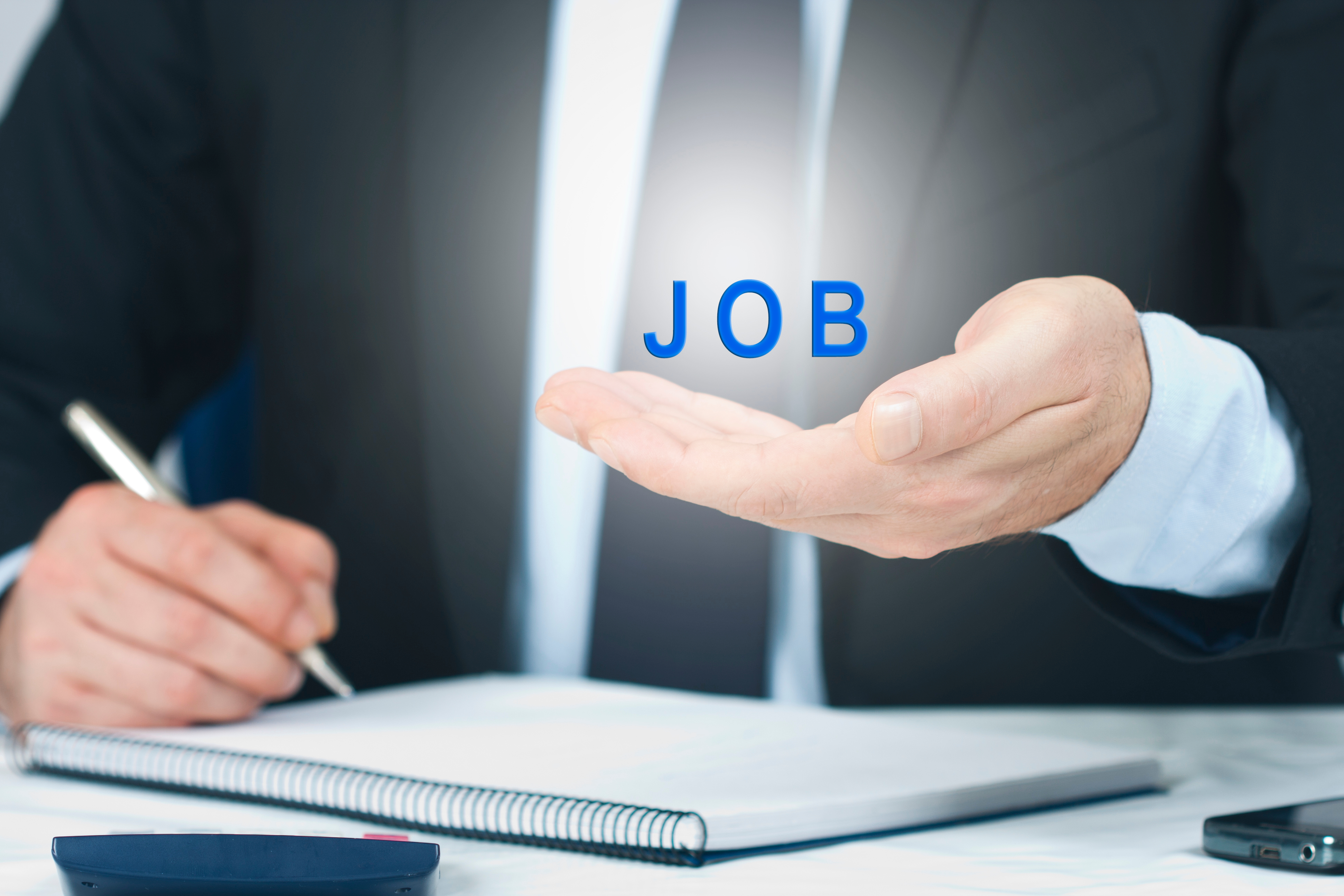 Employment Concept - executive writing holding word graphic_job_in hand