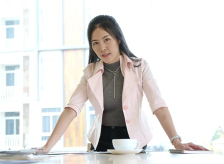 Empowering Female Entrepreneurs - businesswoman standing at desk