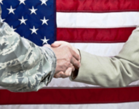 Military Networking - Soldier and Civilian Shaking hands