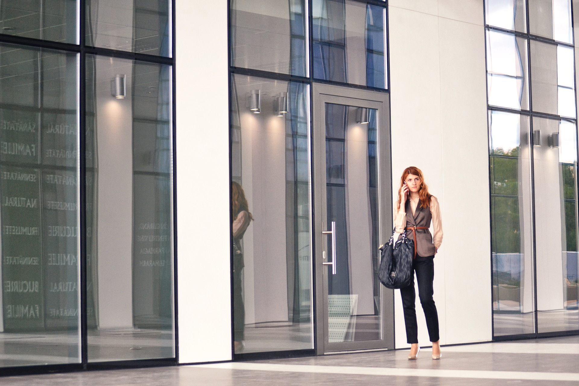 Counteroffers - business woman on phone in front of office building